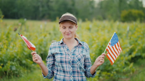 Young-Woman-Farmer-Holding-The-Usa-Flag-On-One-Side-And-The-Canada-Flag-On-The-Other