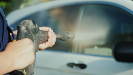Hands-Of-A-Car-Washer-With-A-High-Pressure-Hose-My-Car-Shallow-Depth-Of-Field-Video