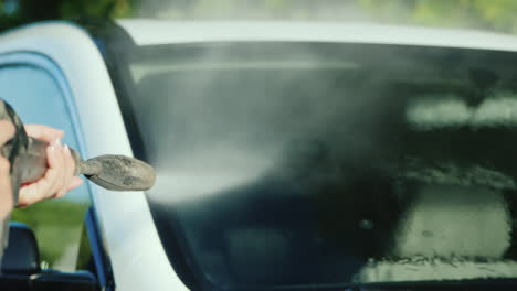 Wash-Off-Dirt-From-A-Car-Windshield-With-A-High-Pressure-Washer