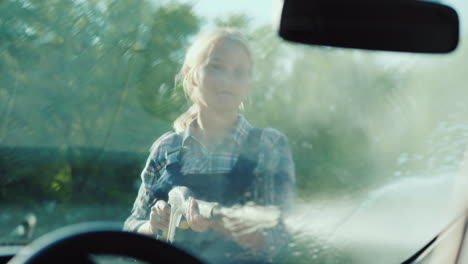 Inside-View-Of-A-Car-A-Woman-Washes-Her-Car-With-A-High-Pressure-Washer