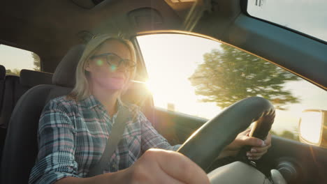 Dreams-Journey-By-Car-Woman-Driver-In-The-Rays-Of-The-Setting-Sun-Driving-A-Car