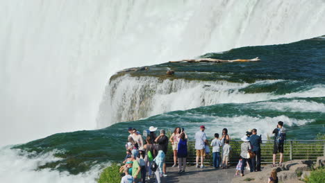 A-Group-Of-Tourists-On-The-Observation-Deck-At-Niagara-Falls---Look-At-One-Of-America-Most-Amazing-N