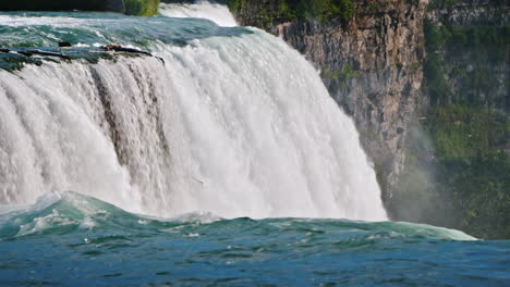 Beautiful-Landscape-With-Niagara-Falls-Stream-Of-Water-Falls-Down-On-The-Background-Of-Rocks