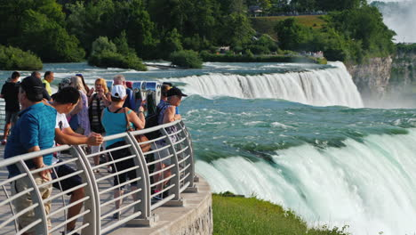 Tourists-On-The-American-Shore-Look-At-The-Amazing-Niagara-Falls