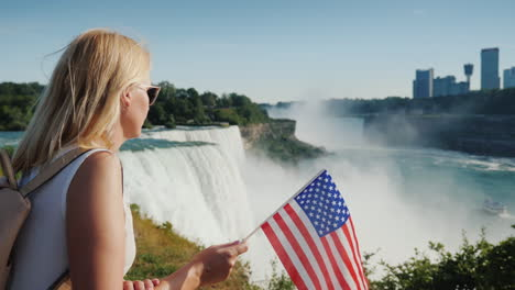 Woman-With-Usa-Flag-Admires-View-Of-Niagara-Falls-From-American-Shore