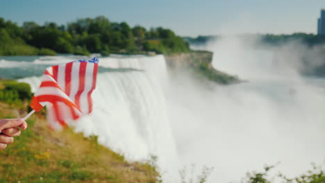 Hand-With-Usa-Flag-On-Niagara-Falls-Background-Travel-America