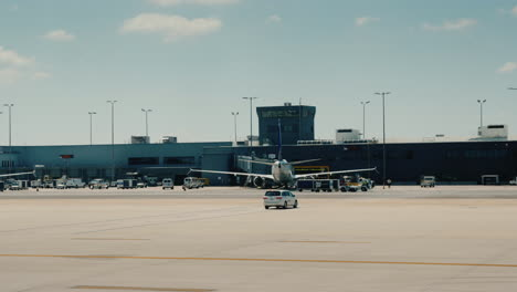 Drive-Along-The-Airport-Terminal-With-Airliners-And-Service-Vehicles