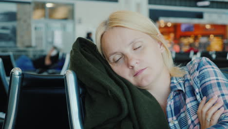 Tired-Passenger-Sleeps-In-Airport-Terminal-While-Waiting-For-His-Flight