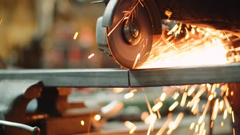 Angle-Grinder-Cutting-Metal-At-Workshop-35