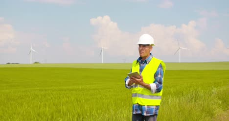 Engineer-Using-Digital-Tablet-At-Windmill-Farm-12