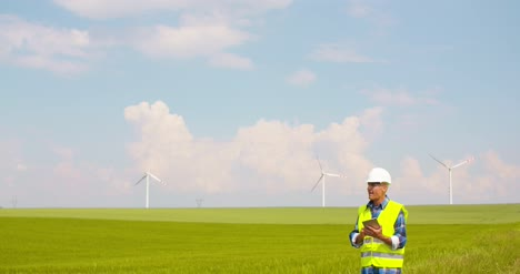 Engineer-Using-Digital-Tablet-At-Windmill-Farm-13
