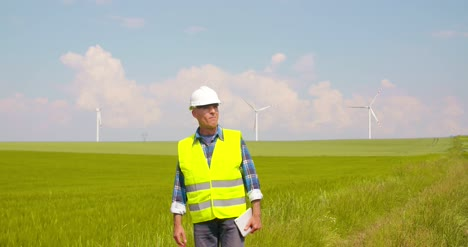 Engineer-Using-Digital-Tablet-On-Wind-Turbine-Farm