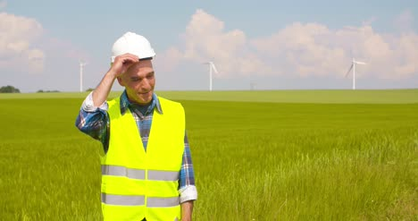 Engineer-Using-Digital-Tablet-At-Windmill-Farm-4