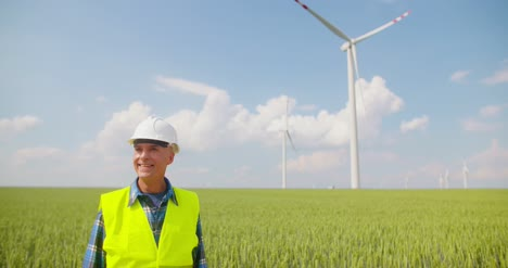 Engineer-Using-Digital-Tablet-On-Wind-Turbine-Farm-3