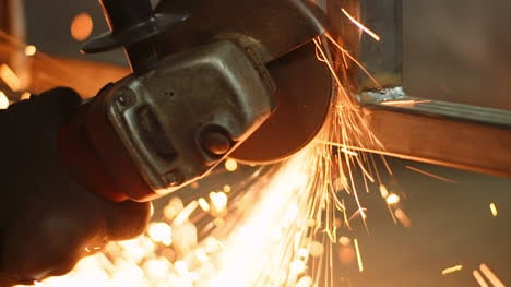 Industry-Worker-Grinding-Metal-With-Angle-Grinder-8