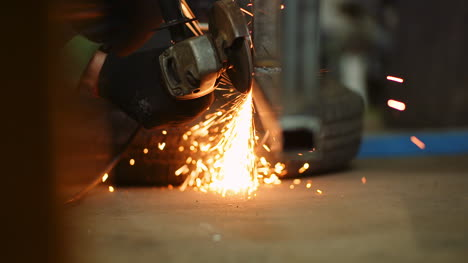 Industry-Worker-Grinding-Metal-With-Angle-Grinder-10