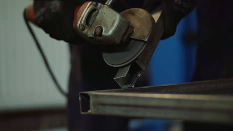 Industry-Worker-Grinding-Metal-With-Angle-Grinder-2