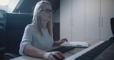 Woman-Working-In-Office-At-Home