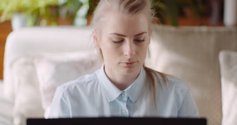 Woman-Working-On-Computer-Thinking-And-Solving-Problem-2