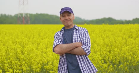 Happy-Male-Farmer-Celebrating-Success-At-Rapeseed-Field-1