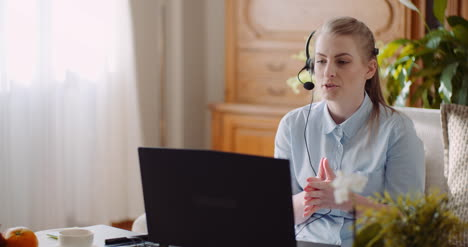 Sales-Representative-In-Headset-Speaking-To-Client-And-Making-Video-Conference-Call-On-Laptop-5