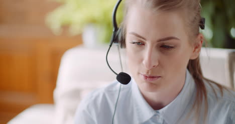 Sales-Representative-In-Headset-Speaking-To-Client-And-Making-Video-Conference-Call-On-Laptop-7