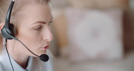 Sales-Representative-In-Headset-Speaking-To-Client-And-Making-Video-Conference-Call-On-Laptop-8