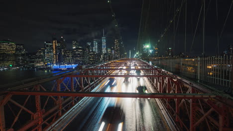 Traffic-Cars-Over-The-Brooklyn-Bridge-Against-The-Backdrop-Of-The-Silhouette-Of-The-Night-In-New-Yor