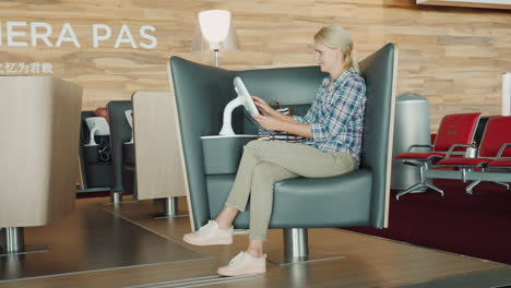 The-Passenger-Uses-The-Entertainment-Terminal-Sits-In-A-Comfortable-Chair