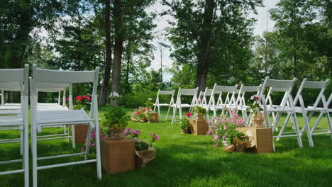 Green-Lawn-With-Rows-Of-White-Wooden-Chairs-Place-For-The-Wedding-Ceremony