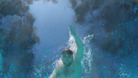 A-Man-Swims-In-The-Pool-Swims-Over-The-Camera-Underwater-Video-Slow-Motion