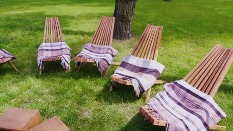 Several-Wooden-Sun-Beds-With-Rugs-On-A-Green-Lawn-A-Place-To-Relax-At-The-Resort-Hd-Video