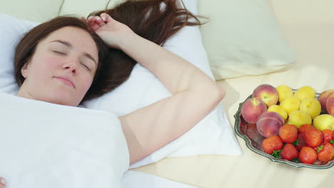 A-Young-Woman-Is-Sleeping-Near-A-Plate-With-Fruit-Bed-And-Breakfast-Romance-And-Honeymoon-Romance-Hd