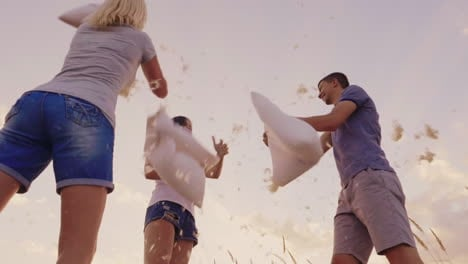 Pillow-Fight-A-Group-Of-Friends-Have-Fun---Beats-Each-Other-With-Pillows-Feathers-Fly-Slow-Motion-Vi