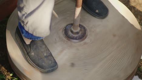 The-Potter-s-Feet-Rotate-The-Potter-s-Wheel-4k-10-Bit-Video