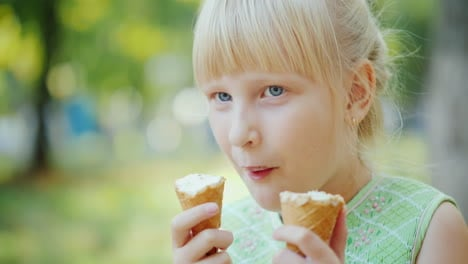 A-6-Year-Old-Girl-Ate-Simultaneously-Two-Cones-Of-Delicious-Ice-Cream-Summer-Holidays-Rest-In-The-Pa