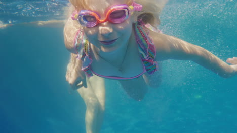 Girl-6-Years-Old-Learns-To-Swim-In-The-Pool-Her-Mother-Helps-Her-Underwater-Slow-Motion-Video