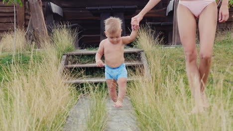 The-First-Steps-Of-The-Baby-The-Boy-Of-1-Year-Uncertainly-Goes-To-Mum-Slow-Motion-Video