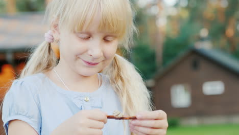 A-6-Year-Old-Girl-Looks-At-A-Small-Snail-In-Her-Hands-Concept---Communication-With-Nature-Life-Aroun