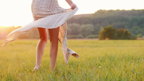 Young-Woman-In-A-Light-Dress-Twist-The-Skirt-Flashes-Across-From-The-Setting-Sun-Slow-Motion-Video