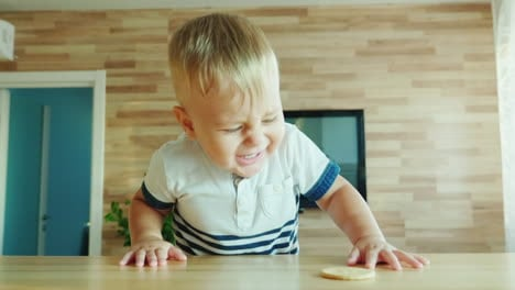 Funny-Kid-Climbs-On-The-Table-For-The-Biscuit-Fun-Video-With-Kids-Concept