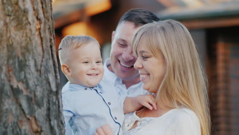 Portrait-Of-A-Young-Happy-Family-Mom-Dad-And-Baby-Boy-Walking-In-The-Park-Slow-Motion-Video