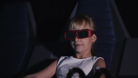 Cool-Blonde-Girl-Is-Watching-A-Movie-In-A-3d-Movie-Theater-It-Blows-The-Wind-The-Seat-Rocks-4k-Video