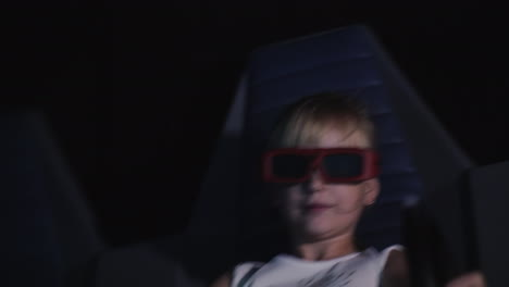 The-Child-Is-Watching-A-3d-Movie-In-The-Cinema-With-Special-Effects-And-Moving-Chairs-4k-Video