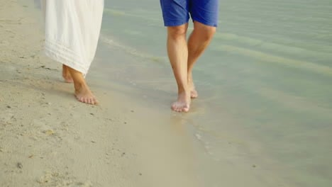 Bare-Feet-Of-A-Man-And-A-Woman-Walk-Along-The-Sand-Along-The-Sea-Holiday-Together-In-The-Tropics-4k-