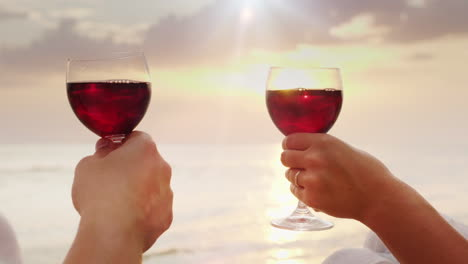 The-Hands-Of-Men-And-Women-Hold-Glasses-With-Wine-They-Cling-To-Them-Against-The-Background-Of-The-S