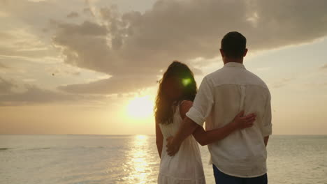 A-Couple-In-Love-Admires-The-Sunset-Over-The-Sea-Back-View