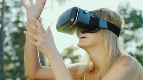 Young-Woman-In-A-Helmet-Of-Virtual-Reality-Touching-Invisible-Wall