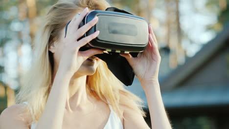 A-Beautiful-Woman-Invites-Into-The-World-Of-Virtual-Reality-Smiling-Putting-On-3d-Helmet-On-Camera-4