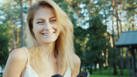 Young-Woman-Puts-On-3d-Glasses-On-Camera-Smiling-Invitation-To-The-World-Of-Virtual-4k-Video